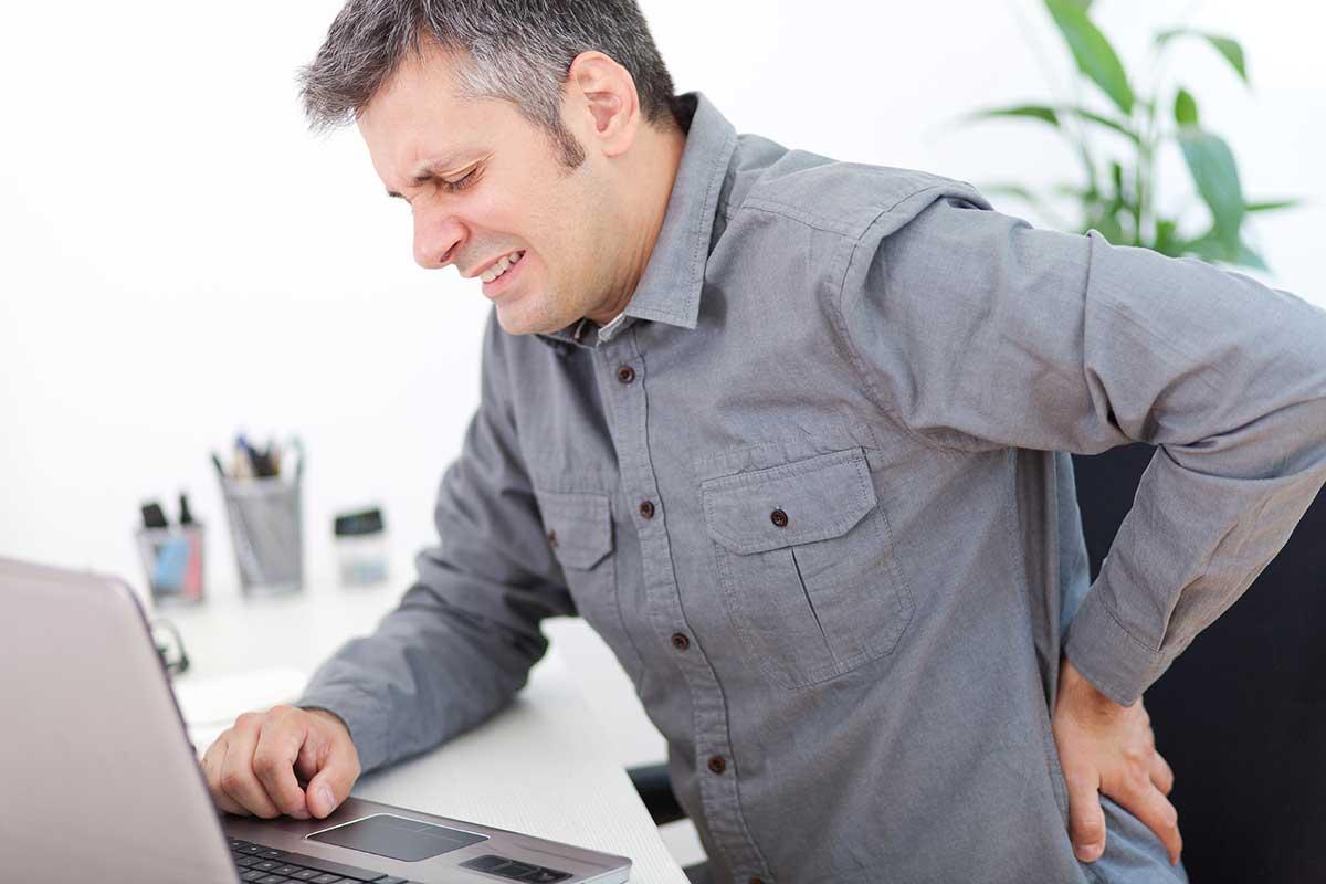 dolor lumbar en el trabajo, dolor de espalda en el trabajo